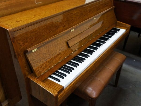 used maeari upright piano